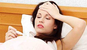 у женщины температура и головная боль